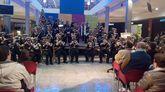 La organizadora del Festival de bandas de Semana Santa, en plena actuación en Odeón