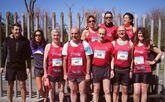 Participantes del Atletismo Deza en el medio maratón gijonés.